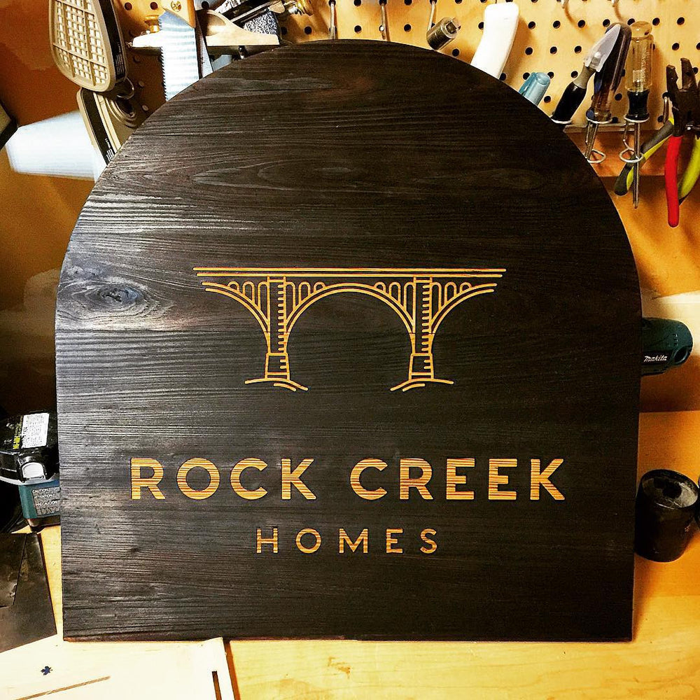 shou sugi ban burnt wood sign for rock creek homes