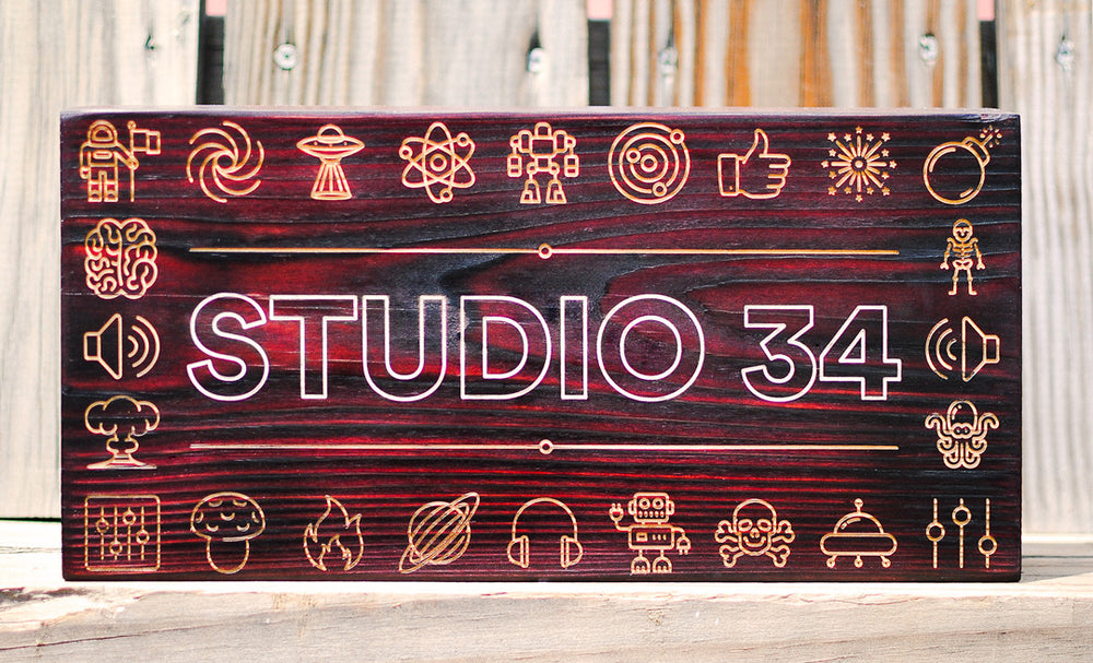 burnt wood and laser engraved sign for studio 34