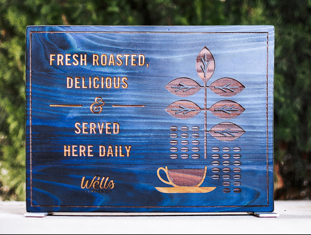Blue and brown burnt wood sign laser etched with color fill for point of purchase at coffee shop