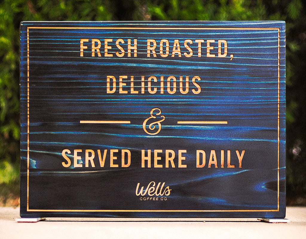 Blue burnt wood table top signage for POP at coffee shop