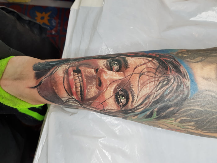 Chips, beans and a hot mug of tea; the tattoos of Simon Cooke