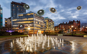 Sheffield peace gardens at dusk with yayo familia products hovering in the sky