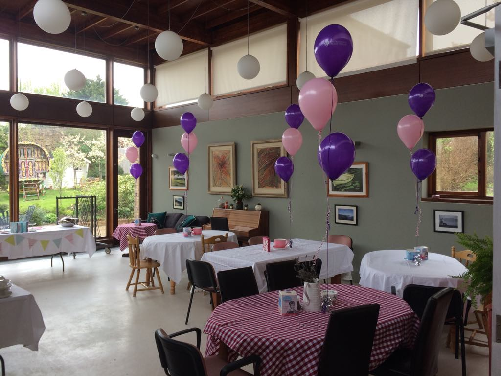 Pink and purple table balloon bouquets.