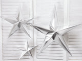 Different sized silver paper star decorations.