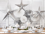 Various types of silver table decorations.