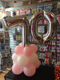 Silver number 70 balloon on top of pink and white balloons.