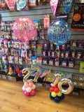 Number shaped balloon designs in different colours with large happy birthday balloon on top.