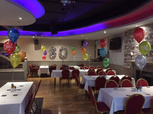 Party venue with balloon decor.