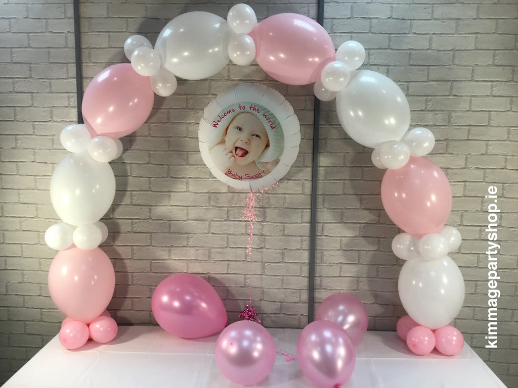 Pink and white balloon arch and photo balloon.