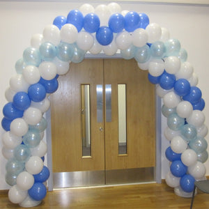 Large blue and white balloon arch over doorway.