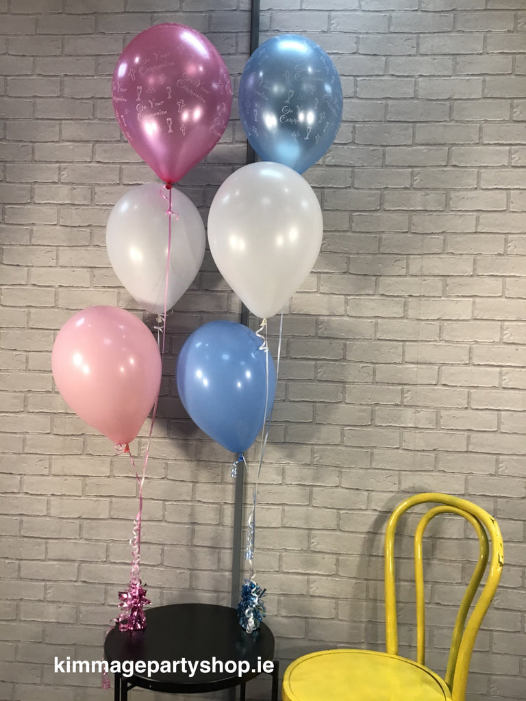 Communion balloon bouquets on foil weights.