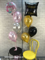 Three latex balloons with a printed foil balloon on top.