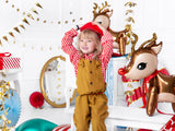 Child with cute Christmas reindeer foil balloons.