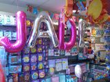 Pink and silver shaped letter foil balloons.