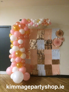 Pink, white and gold coloured organic style balloon arch.
