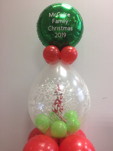 Toy elf in clear balloon with personalised balloon on top.