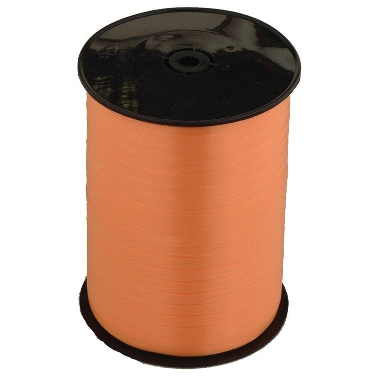Roll of orange ribbon.