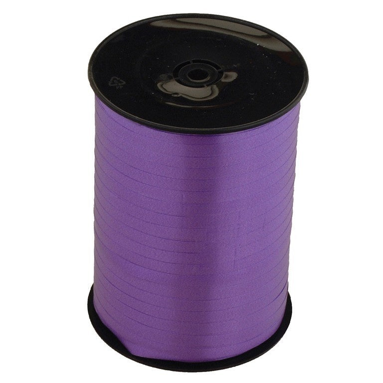 Roll of purple ribbon.