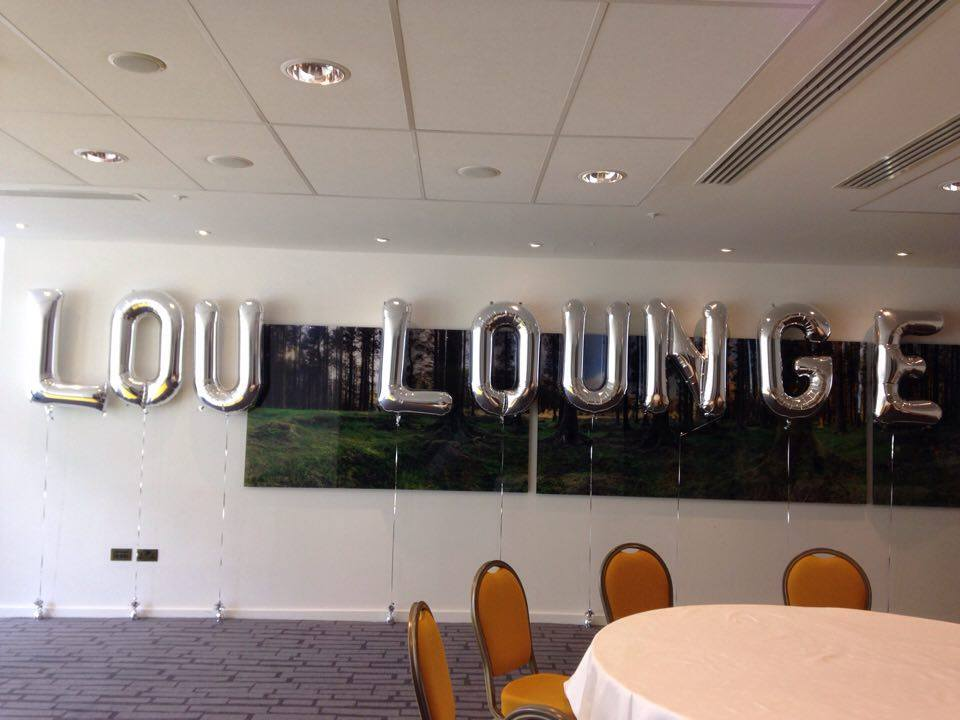 Large silver letter shaped balloons.