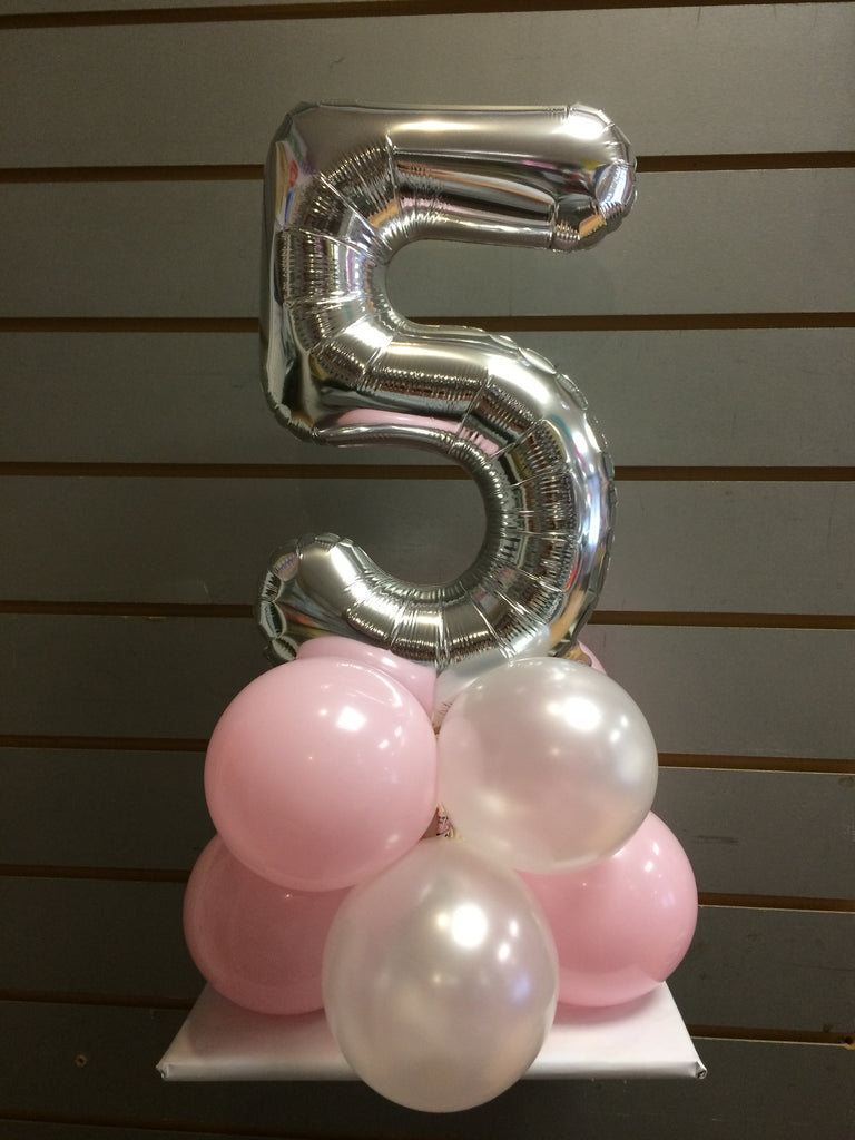 Silver number 5 balloon on top of pink and white balloons.