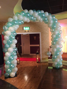 Teal and white coloured spiral balloon arch for a wedding reception.