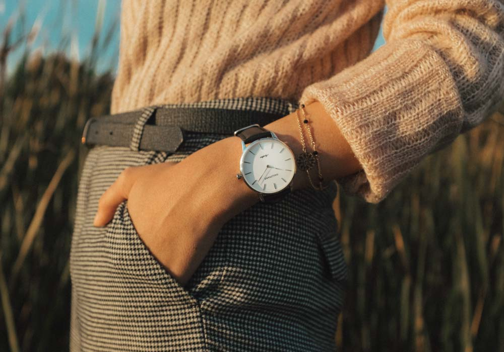 Woman in pink sweater and grey pants wearing the Gallivant Aquafino watch