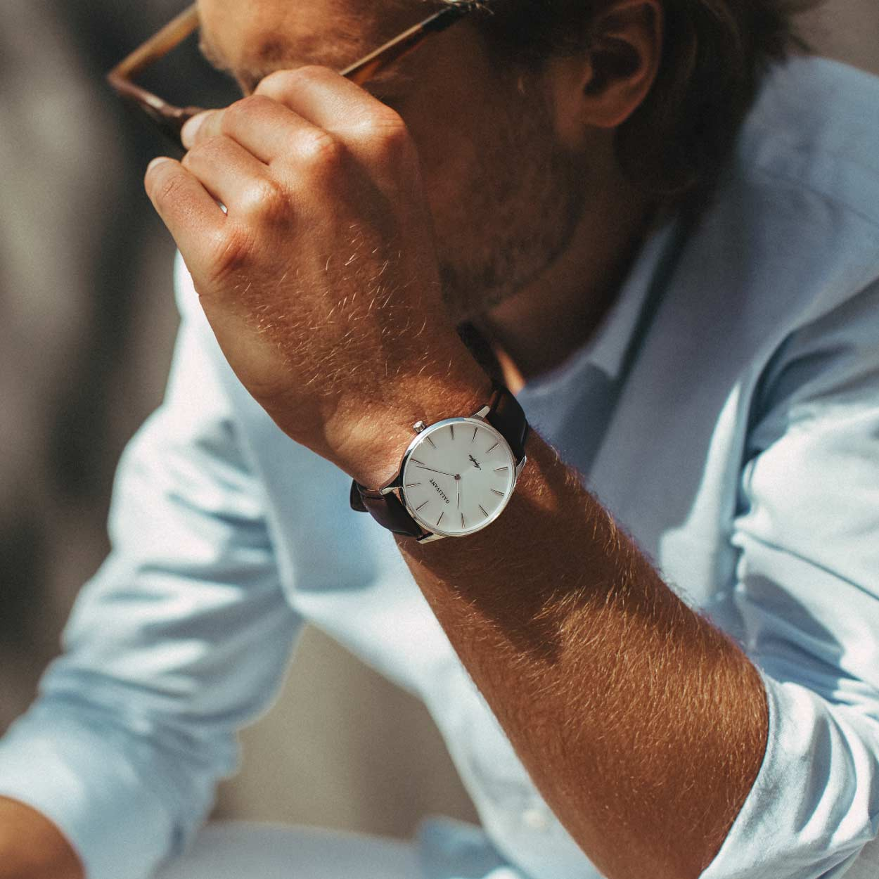 Man with sunglasses and blue shirt wearing a Gallivant Aquafino watch