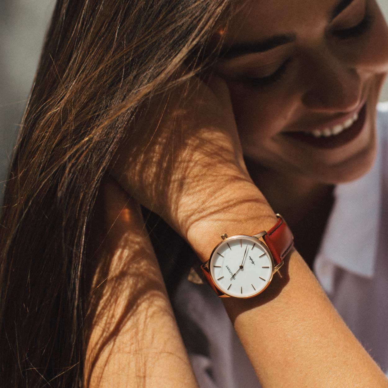 Woman Smiling woman in white shirt wearing a Gallivant Aquafino watch