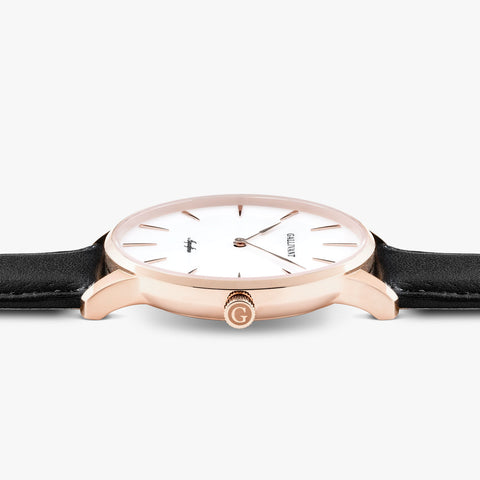 Side of Gallivant Men's Aquafino watch with black leather strap, white dial and rose gold case.