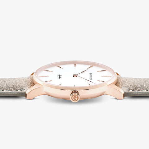 Side of Gallivant Men's Aquafino watch with light grey suede strap, white dial and rose gold case.