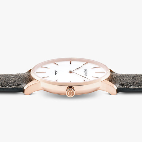 Side of Gallivant Men's Aquafino watch with charcoal grey suede strap, white dial and rose gold case.