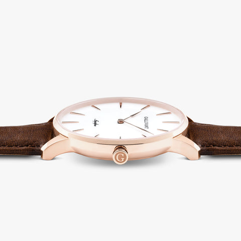 Side of Gallivant Men's Aquafino watch with chestnut brown leather strap, white dial and rose gold case.