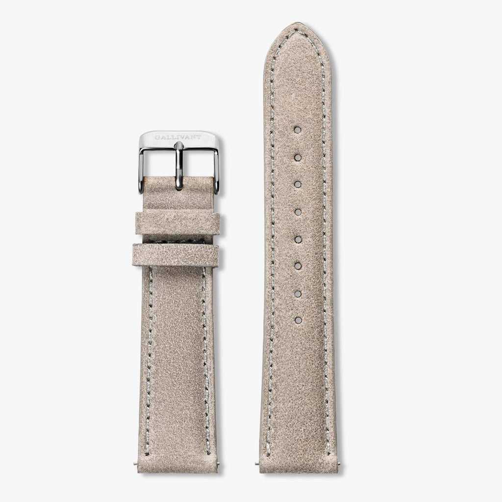 Light grey suede strap with silver buckle and quick-release system.