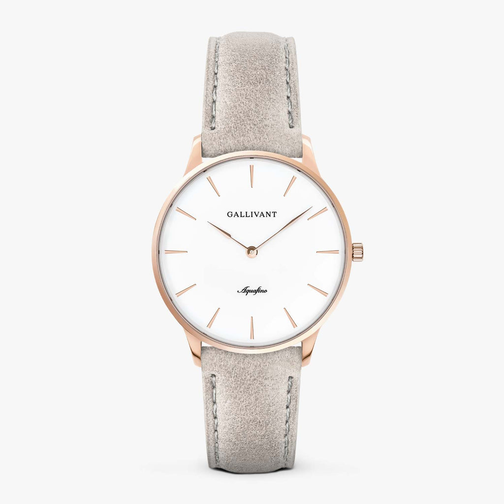 Gallivant Women's Aquafino watch with light grey suede strap, rose gold case and white dial.