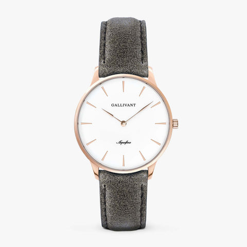 Gallivant Women's Aquafino watch with charcoal grey suede strap, rose gold case and white dial.