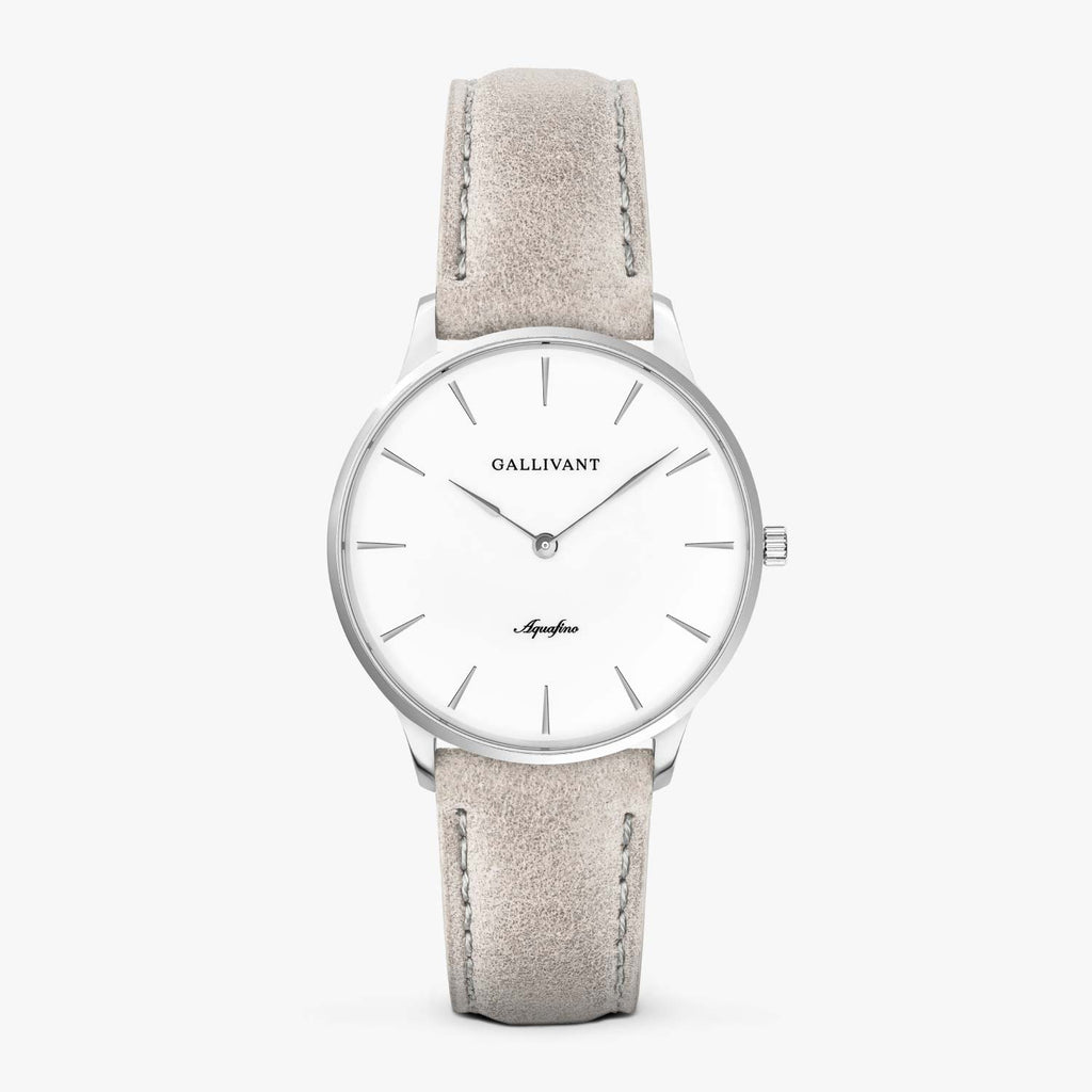Gallivant Women's Aquafino watch with light grey suede strap, silver case and white dial.