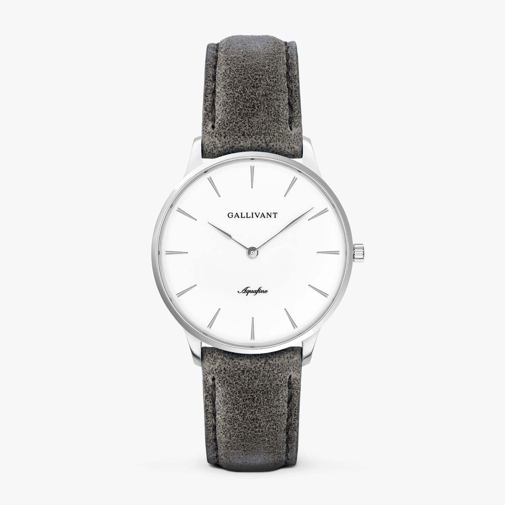 Gallivant Women's Aquafino watch with charcoal grey suede strap, silver case and white dial.