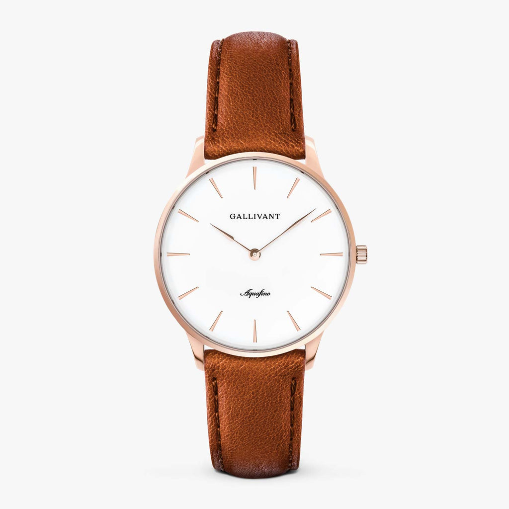 Gallivant Women's Aquafino watch with tan leather strap, rose gold case and white dial.