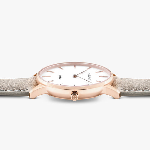 Side of Gallivant Women's Aquafino watch with light grey suede strap, white dial and rose gold case.