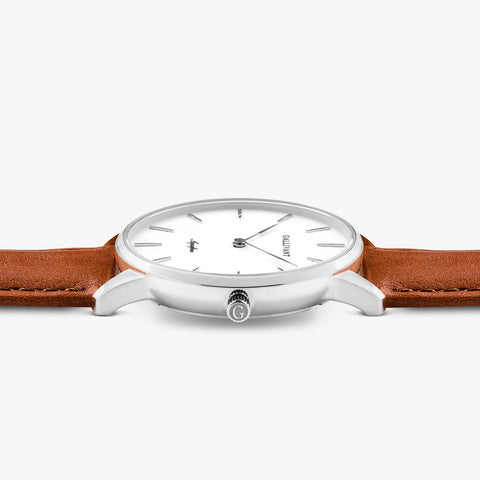 Side of Gallivant Women's Aquafino watch with tan colored leather strap, white dial and silver case.