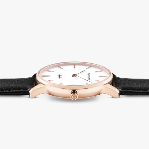 Side of Gallivant Women's Aquafino watch with black leather strap, white dial and rose gold case.