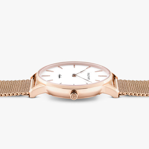 Side of Gallivant Women's Aquafino watch with stainless steel rose gold mesh strap, white dial and rose gold case.