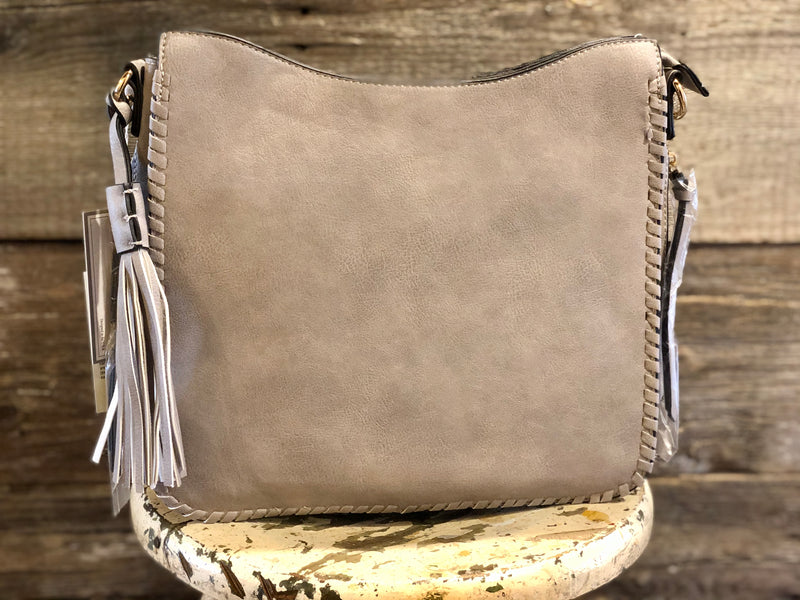 Crossbody with tassel trim and whipstitch edge