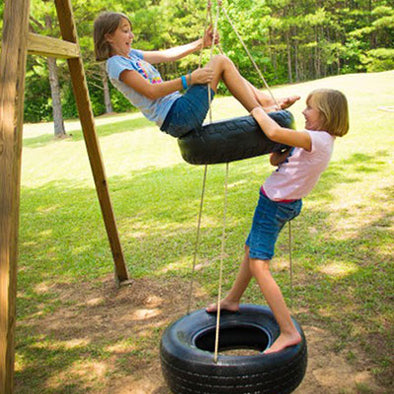 children playing on two tier Twister tire Swing