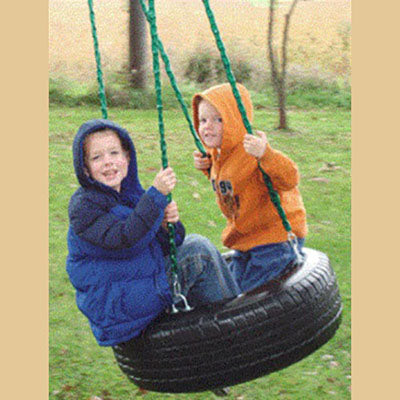 Children playing on Deluxe 4-Chain Tire Swing