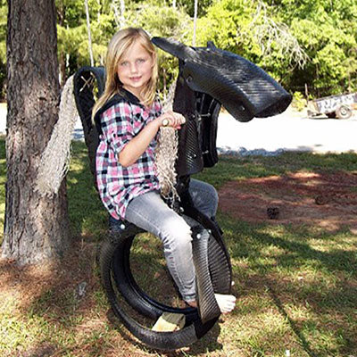 Child on Classic Pony Tire Swing
