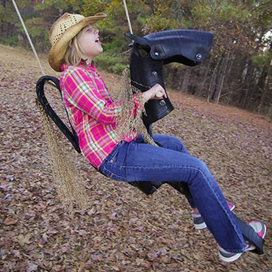 child swinging on Roping Pony Tire Swing