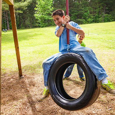 Child Playing on Old-Fashioned Vertical Tire Swing