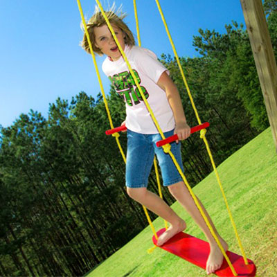 Child playing on red Wind Surfer board Swing with yellow rope
