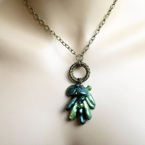 A Blue and Green Sea Freshwater Pearl Necklace
